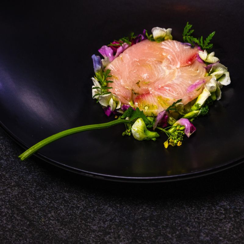 A Plate Of Food With A Purple Flower